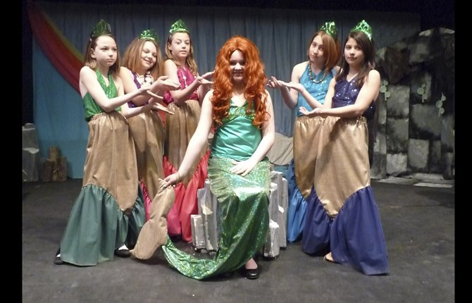 "In a play about a magical kingdom under the sea the mermaid Ariel (played by Gillian Woods, center) longs to leave her ocean home and explore the world abover her. Disney's ""The Little Mermaid Jr."" is playing at Dallesport Elementary School on Friday, March 22 and Saturday, March 23 at 7p.m. Admission is free. The musical is based on the 2008 Broadway production and the 1989 animated feature film.  The cast of 27 is made up of third through sixth graders who have been rehearsing for 12 weeks."