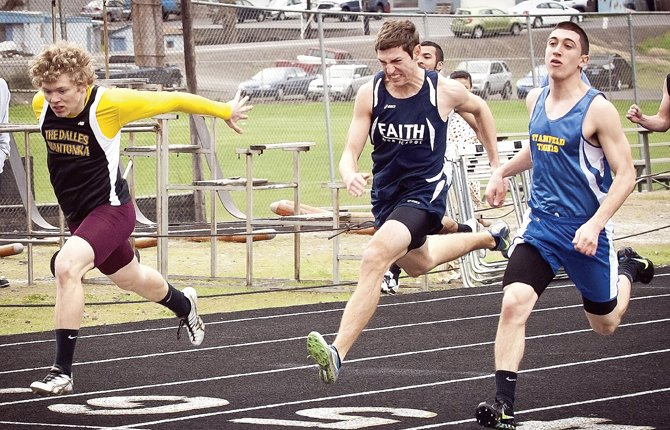 Blake Diede, of The Dalles Wahtonka, left, makes a strong finish in his heat of the 100-meter dash during Saturday's invitational track meet in The Dalles. Many local sports programs were in action setting personal records and establishing times for the start of the 2013 spring track and field campaign.