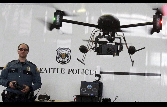 Seattle Police officer Reuben Omelanchuk is at the controls of the department&#39;s new, small radio-controlled Draganflyer X6 drone with a camera attached, in Seattle, Wash. As the nation debates the use of drones to hunt terrorism suspects abroad, Oregon lawmakers are considering legislation that would regulate how drones could be used on the home front and will consider three bills this session. 	