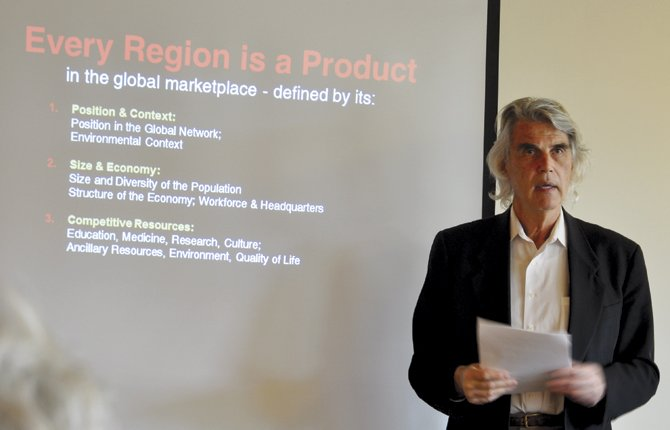 MICHAEL GALLIS, one of the country's leading experts in regional development strategies, speaks about local opportunities before a group of about 30 people interested in local growth March 14 as part of a Port of The Dalles strategic planning meeting.