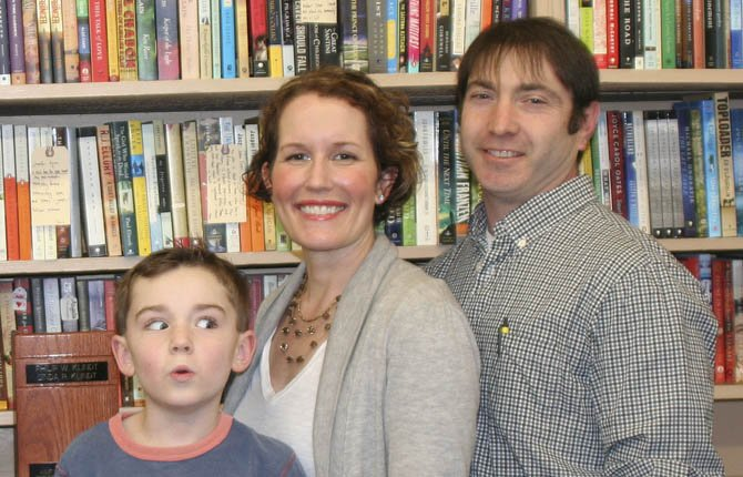 HUSBAND AND WIFE, Kristin Klindt and Joaquin Perez, shown with son Henry, have taken on full ownership of Klindt's Booksellers and Stationers.