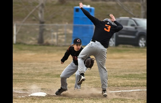 Culver third baseman Wyatt Rufner, left, tags out Sherman runner Riley Brown as he attempts to steal third in Tuesday's game against Culver in Moro March 19.