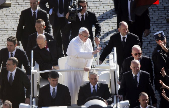 Pope Francis waves upon his arrival in St. Peter's Square for his inaugural Mass, at the Vatican, Tuesday, March 19, 2013.
