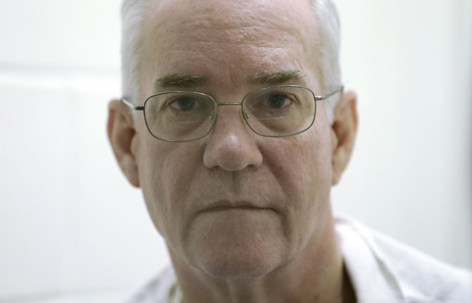 inmate Ed Graf looks into a camera during an interview March 11 at the Alfred Hughes State Prison in Gatesville, Texas. Graf was given life in prison 25 years ago for killing his two stepsons by locking them in a shed and setting it on fire, based on expert testimony and conclusions that have largely been disavowed by the state fire marshal. A state district judge has recommended a new trial.