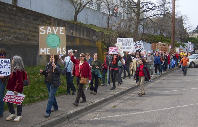 COAL OPPONENTS marched in Hood River March 13 in an attempt to persuade regulatory agencies to oppose a coal transport application by Australian firm Ambre Energy.