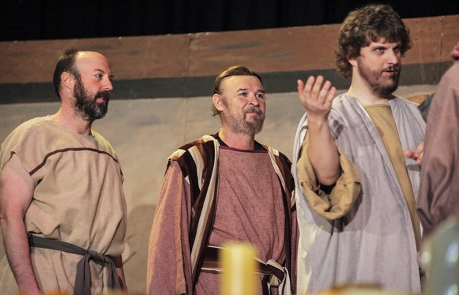 Nick Lindskoog, at right, portrays the Disciple Andrew as he greets Jesus at the Last Supper scene from last year's production of the Last Days of Jesus. At left is Bill Palmer, who played James the Lesser; and center is Ramón Flores as Thaddeus.