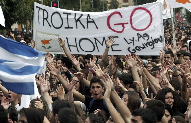 Cypriot students shout slogans near the presidential palace in capital Nicosia, on March 26. Banks across Cyprus remain firmly padlocked Tuesday after financial authorities extended the country's bank closure.