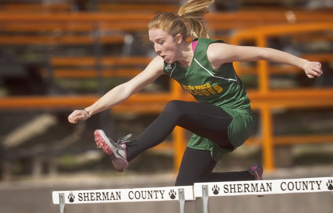 SOUTH WASCO County junior Katherine Popchock competes in the hurdles Saturday, March 23 in Moro.