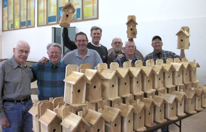 Volunteers put together bird houses for Chenowith Elementary students to decorate and take home. From left: Bill Rumble, Dill Magnuson, Dave Cornell, Keith Stelzer, Tharon Keller, Ben Neumayer and John Byers in the fellowship hall of Gateway Presbyterian Church, which made a 10-year committment to help Chenowith through volunteers and donations.