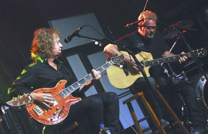Night Ranger singer and bassist Jack Blades, left, and guitarist Brad Gillis perform at the Brennan Rock & Roll Academy in Sioux Falls, S.D. The center will give Boys & Girls Clubs members a chance to learn guitar, bass, drums, keyboards and vocals.