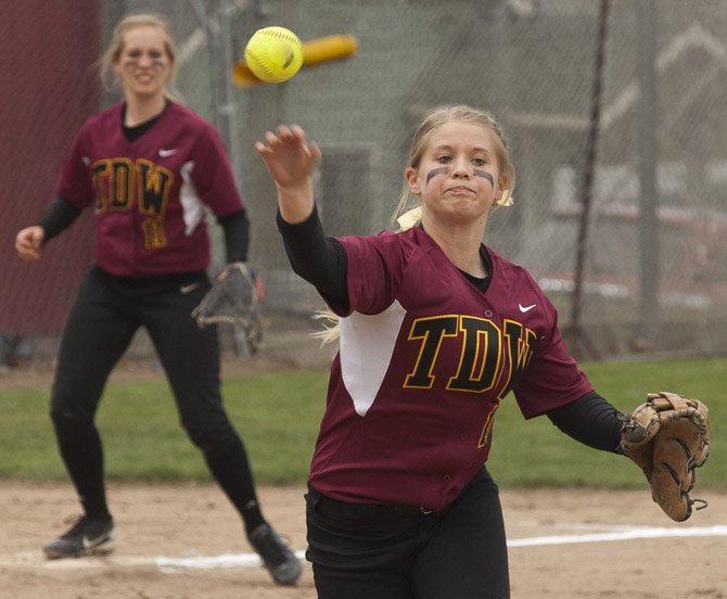 Morgan Triperinas makes a play at first during Tuesday's tournament game against Molalla.