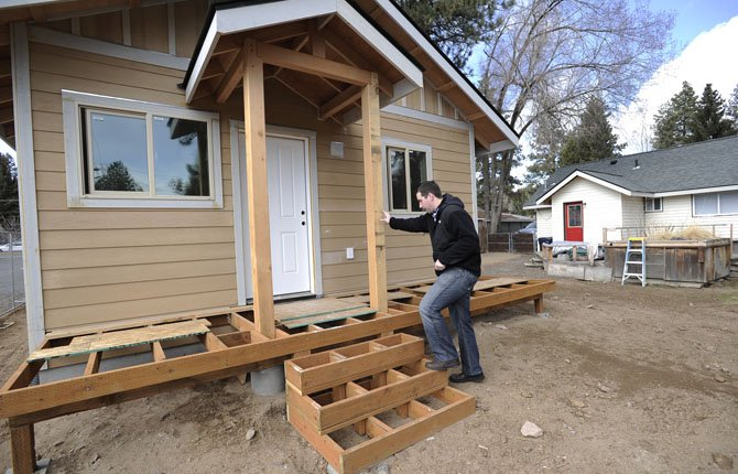 Ryan Davies walks into the accessory dwelling behind his home March 21 in Bend.