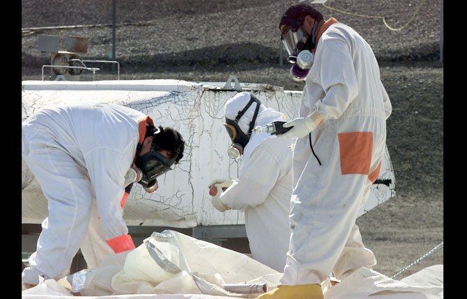 WORKERS at tank farms on the Hanford Nuclear Reservation near Richland, Wash., measure for radiation and the presence of toxic vapors. A nuclear safety board has warned a key U.S. senator that underground tanks holding radioactive waste at the nation's most contaminated nuclear site pose a possible risk of explosion. Concerns that hydrogen gas could build up inside the tanks and lead to an explosion at south-central Washington state's Hanford Nuclear Reservation have been known for some time.