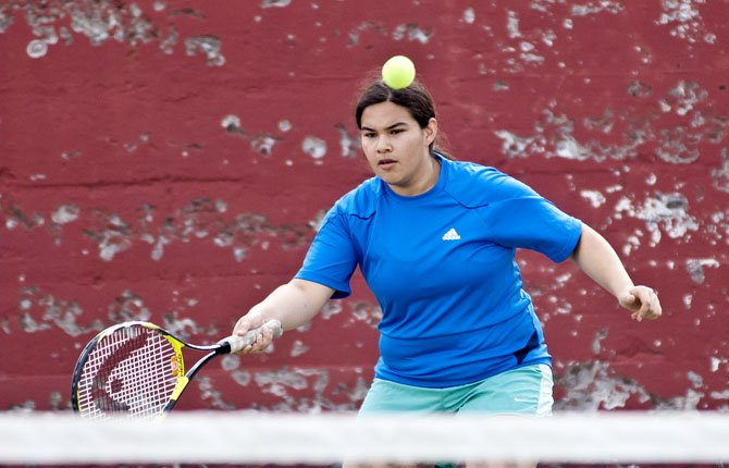 Leslie LunaLopez competes in fourth level singles during Tuesday's matchup in The Dalles against Hermiston.