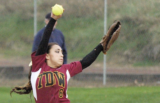 TDW pitcher Carley Gowdy whirls in for a pitch in a recent varsity softball game in The Dalles. The No. 9-ranked Eagle Indians left eight runners in scoring position in suffering a 4-3 non-league loss in eight innings Tuesday night versus Lakeridge. File photo