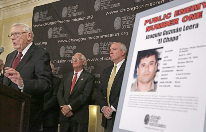"Art Bilek of the Chicago Crime Commission, left, announces that Joaquin ""El Chapo'' Guzman, a drug kingpin in Mexico, has been named Chicago's Public Enemy No. 1, during a February news conference in Chicago."