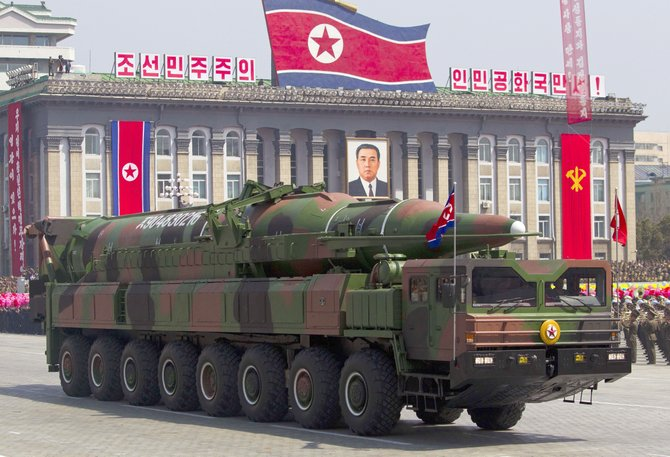 In this April 15, 2012 file photo, a North Korean vehicle carrying a missile passes by during a mass military parade in Pyongyang's Kim Il Sung Square. Some suspect the missile was actually a mock-up.