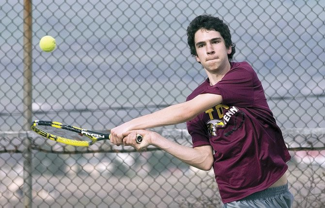 TDW'S Cole McDowell backhands a shot at his opponent during tennis play this season. McDowell cashed in one of two wins versus Hermiston. File photo