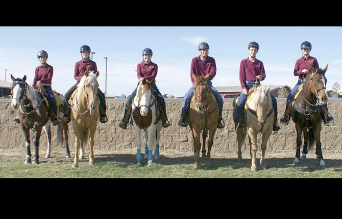THE DALLES WAHTONKA equestrians take time out of practice for a group photo. The Eagle Indian team competed this past weekend in Redmond at a Oregon High School event and chalked up 68 points for second place in the medium team classification. In two Central District runs this season, the Tribe has made a significant jump in the rankings with top scores.