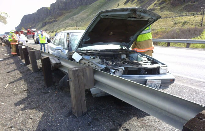 Oregon State Police investigate the scene of a fatal crash on I-84 on April 6.