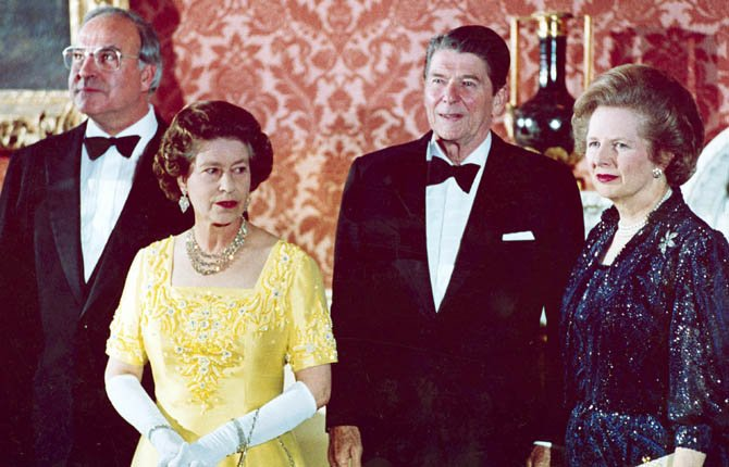 FILE - In a June 10, 1984 file photo, Britain's Queen Elizabeth II, second left, stands with, West German Chancellor Helmut Kohl, left, U.S. President Ronald Reagan, second right, and Britain's Prime Minister Margaret Thatcher at London's Buckingham Palace, prior to a dinner for summit leaders. Thatchers former spokesman, Tim Bell, said that the former British Prime Minister Margaret Thatcher died Monday morning, April 8, 2013, of a stroke.  She was 87.