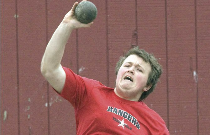 DUFUR'S Brandon Thenell makes his shotput toss in track and field action this year. Thenell finished third this weekend in Riverside. File photo