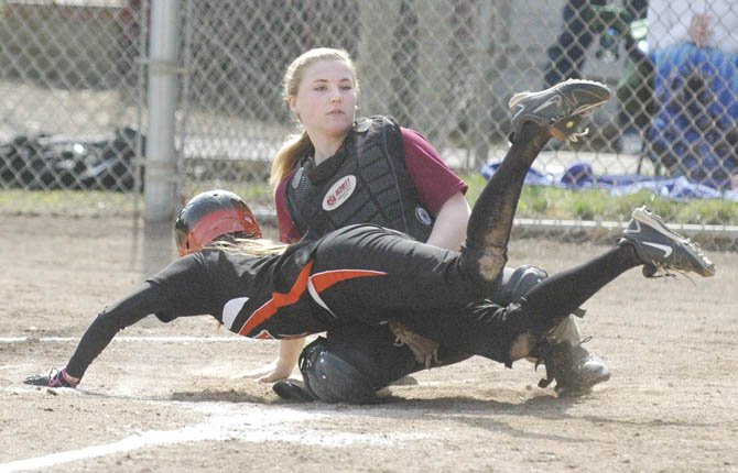 TDW catcher Katherine Kramer (top) blocks home plate on a play during softball action this season. Monday in Bend, TDW beat Mountain View, 16-4.