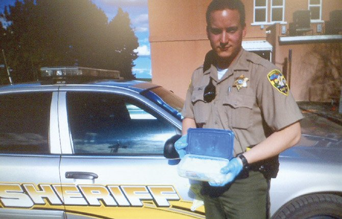 SHERMAN COUNTY Dep. Daniel Hall holds about 1.3 pounds of methamphetamine seized during a routine traffic stop near Wasco.