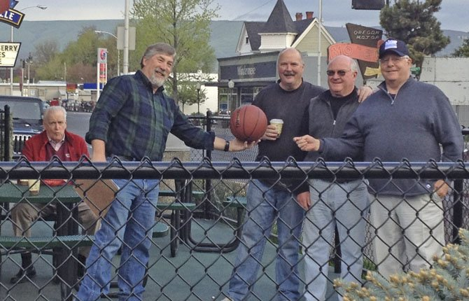 "THE ""INFAMOUS"" BURGERVILLE morning coffee group prepares April 10 to start the Great Burgerville Free Throw Shootout between Mike Woodside and John Hutchison. Pictured from left are, Dave Griffith, Rod Runyon, Hutchison, Woodside and Steve Lawrence."