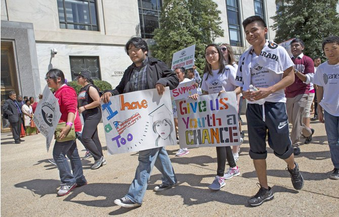 "Students from Staten Island, New York, march past the Dirksen Senate Office Building on Capitol Hill in Washington, April 10, on their way to attend the ""Rally for Citizenship."""