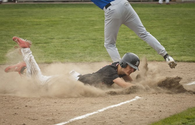 DUFUR base runner Bryson Caldwell slides safely into third base during the opening game of Friday's Blue Mountain Conference baseball doubleheader at Dufur City Park. The Rangers vaulted into sole possession of first place after a two-game sweep by scores of 10-0 and 17-3 over the Sherman Huskies.