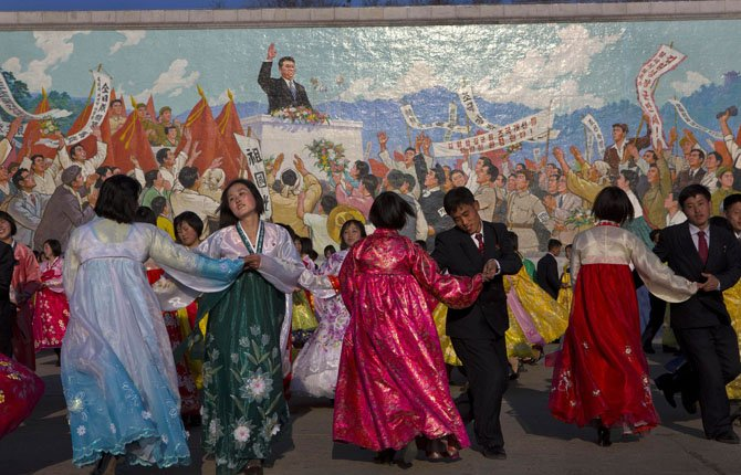 North Koreans dance together beneath a mosaic painting of the late leader Kim Il Sung during a mass folk dancing gathering in Pyongyang April 11 to mark the anniversary of the first of many titles of power given to leader Kim Jong Un after the death of his father Kim Jong Il. There is also a logic behind North Korea's behavior steeped in internal politics.