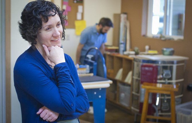Aimee Herring of aimeeceramics.com in Hood River, left, chats with a visitor during the 7th annual Gorge Artists Open Studios tour April 14.