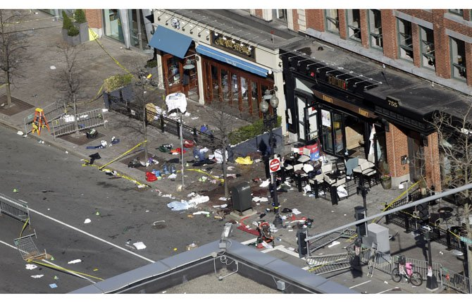 ONE OF the blast sites on Boylston Street near the finish line of the 2013 Boston Marathon in Massachusetts is seen April 16, one day after bomb blasts killed three and injured over 170 people. FBI agents searched a suburban Boston apartment overnight and appealed to the public for amateur video and photos that might yield clues to who carried out the Boston Marathon bombing.