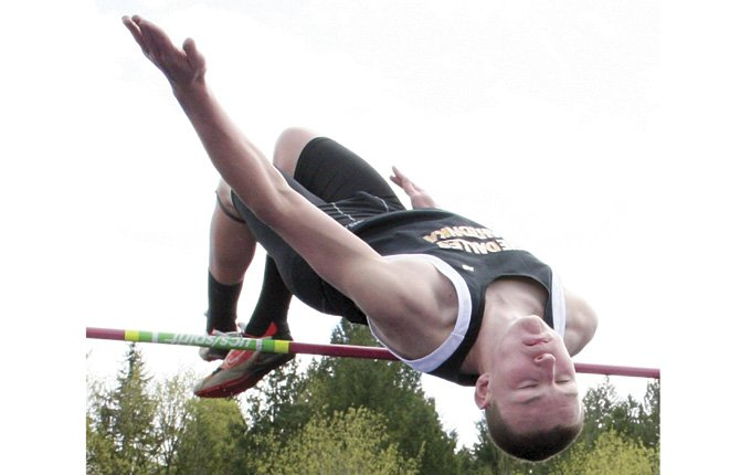 TDW'S Zach Nerdin flies high in Saturday's high jump at the Barlow Relays in Gresham. Nerdin had a height of 5-11 for second place.