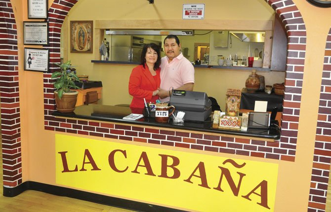 CARLOS AND SOCORRO Quezadas have opened La Cabaña Mexican Restaurant at 400 E. Second St. in downtown The Dalles. The restaurant celebrates its grand opening May 4.