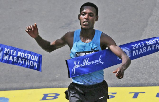 Lelisa Desisa of Ethiopia crosses the finish line to win the men's division of the 2013 Boston Marathon in Boston April 15. His Boston Marathon victory was eclipsed later by deadly bombings at the event.