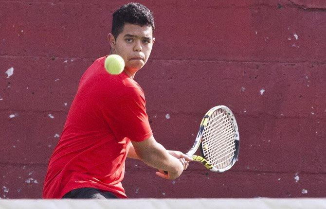 Playing first singles, The Dalles Wahtonka's Carlos Barajas sets up for a backhand return shot in Tuesday's varsity tennis match against Hermiston in The Dalles. Barajas lost his showdown versus St. Helens' Caleb Johnston by scores of 6-4 and 7-5.