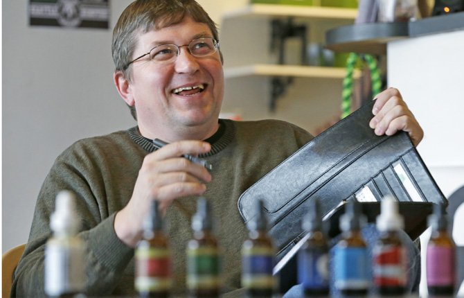 Mike Steenhout, comptroller of Washington's Liquor Control Board, smiles during a presentation about marijuana plant extracts at a medical marijuana clinic in Seattle. While the state has hired a Massachusetts firm to serve as its official marijuana consultant, the Liquor Control Board is also doing its own work — a cannabis crash-course.
