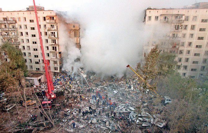 IN THIS Sept. 9, 1999, file photo fire and smoke rise from a destroyed apartment building in Moscow, an attack blamed on Chechen militants, as Russian Emergency Situations Ministry officers and firefighters try to save people. Two suspects in the Boston Marathon bombing have been identified to The Associated Press as coming from a Russian region near Chechnya. In the past, insurgents from Chechnya and neighboring restive provinces in the Caucasus have been involved in terror attacks in Moscow and other places in Russia.