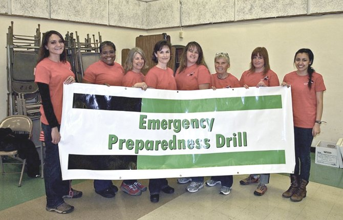 WASCO COUNTY Medical Reserve Corps members, from Left: Kristy Beachamp, Deitra Greene, Susan Froelich, Connie Jubitz, Leigh Stratton, Dianne Kerr, Grace Anderson and Andrea Peña, promote an emergency preparedness drill.