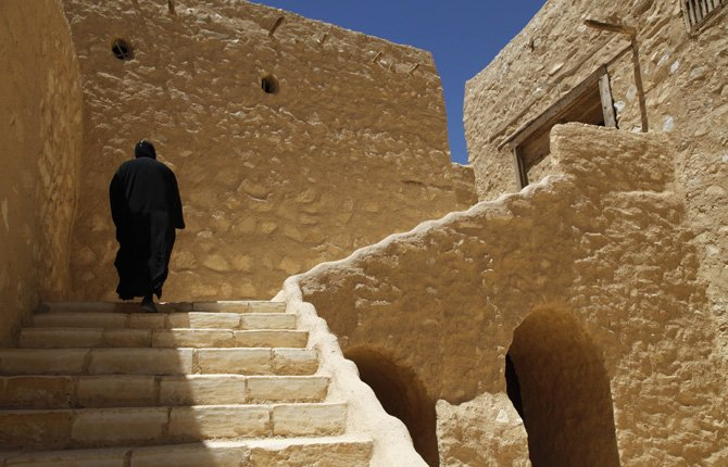 A monk walks on the grounds of the ancient monastery of St. Anthony, southeast of Cairo, Egypt, April 16, 2013.