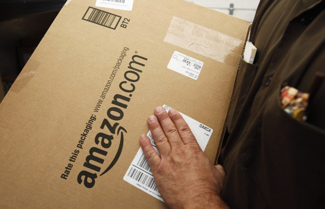 an Amazon.com package is prepared for shipment by a UPS driver in Palo Alto, Calif. States could force Internet retailers to collect sales taxes under a bill that overwhelmingly passed a test vote in the Senate  April 22.