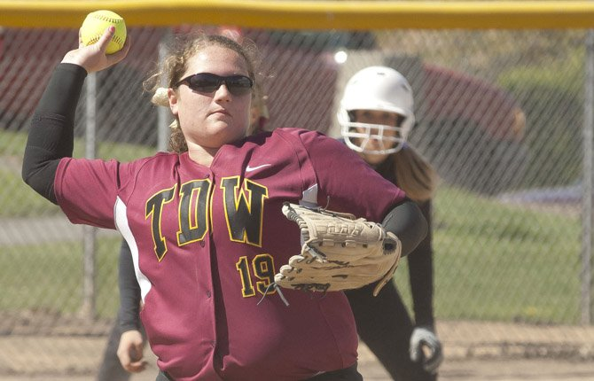 TDW softball player Melanie Taphouse fires a ball to first for an out in varsity action this season in The Dalles. Saturday, Taphouse and the Eagle Indians salvaged a split with No. 1-ranked Pendleton.