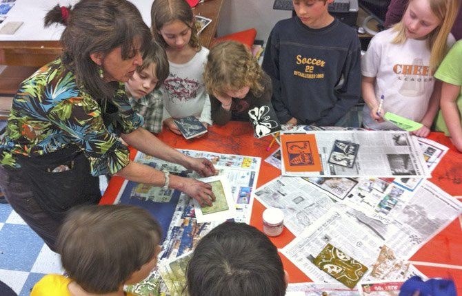 Artist in residence Abby Merickel helps Mosier Community School students create prints to sell at the Made for Mosier auction and fundraiser.