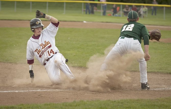 THE DALLES WAHTONKA baserunner Steve Bartells, left, slides safe into third base ahead of the tag of Pendleton's Chad McCoy (12) during Tuesday's Columbia River Conference baseball game in The Dalles. The No. 4-ranked Eagle Indians overcame a 10-8 deficit with five runs on four hits in the bottom of the sixth inning and reliever Dakota Walker made it hold up in the Tribe's 13-8 defeat of the Buckaroos.