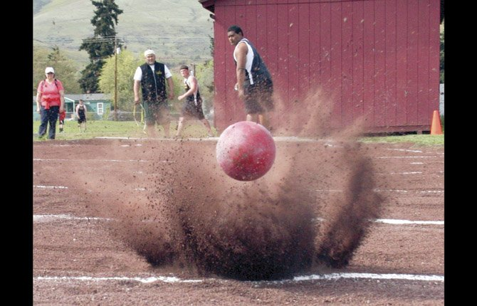 THE DALLES WAHTONKA trackster Lio Tunai watches as his shotput toss sails 54-feet-11 inches in Tuesday's track and field duel in The Dalles. Tunai is ranked first in the 5A shotput class.