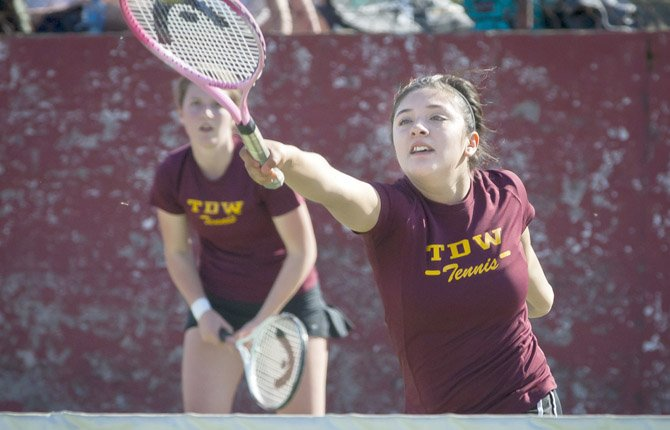 The Dalles Wahtonka's Abi Herriges, right, slams a shot over the net at her Hood River apponents as third doubles partner Cinthia Vasquezlooks on during Wednesday's matchup in The Dalles April 24.