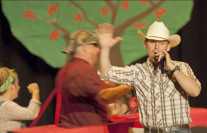 MARCUS DENNEY controls the microphone during Columbia State Bank's first-place act at the Northwest Cherry Festival Lip Sync contest Thursday, April 25, at The Dalles Wahtonka HIgh School auditorium.
