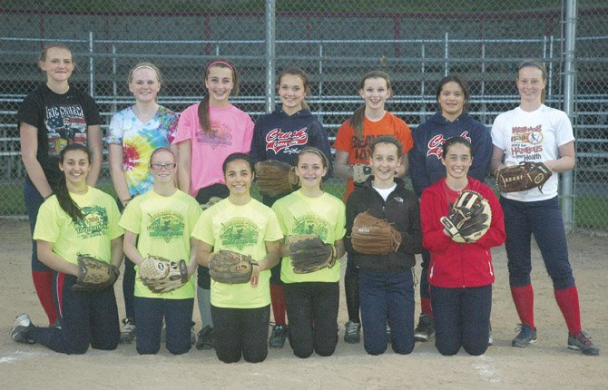 MEMBERS OF THE Dalles 14U Cherry Crush softball team takes time out of practice for a picture Tuesday in The Dalles. The players are (pictured from left to right, in the front row), Haley Bechnel, Shaynie Watson, Jessika Nanez, Emma Weir, Kathryn Bradford and Kailin Hoylman. Pictured (from left to right, in the back row), Abby Walker, Abby Robertson, Jodi Thomasian, Laney Schanno, Sarah Helyer, Jez Ferrell and Sierra Watson. Starting at 7:30 p.m. tonight, the Crush hosts Hood River at 16th Street Ballpark.